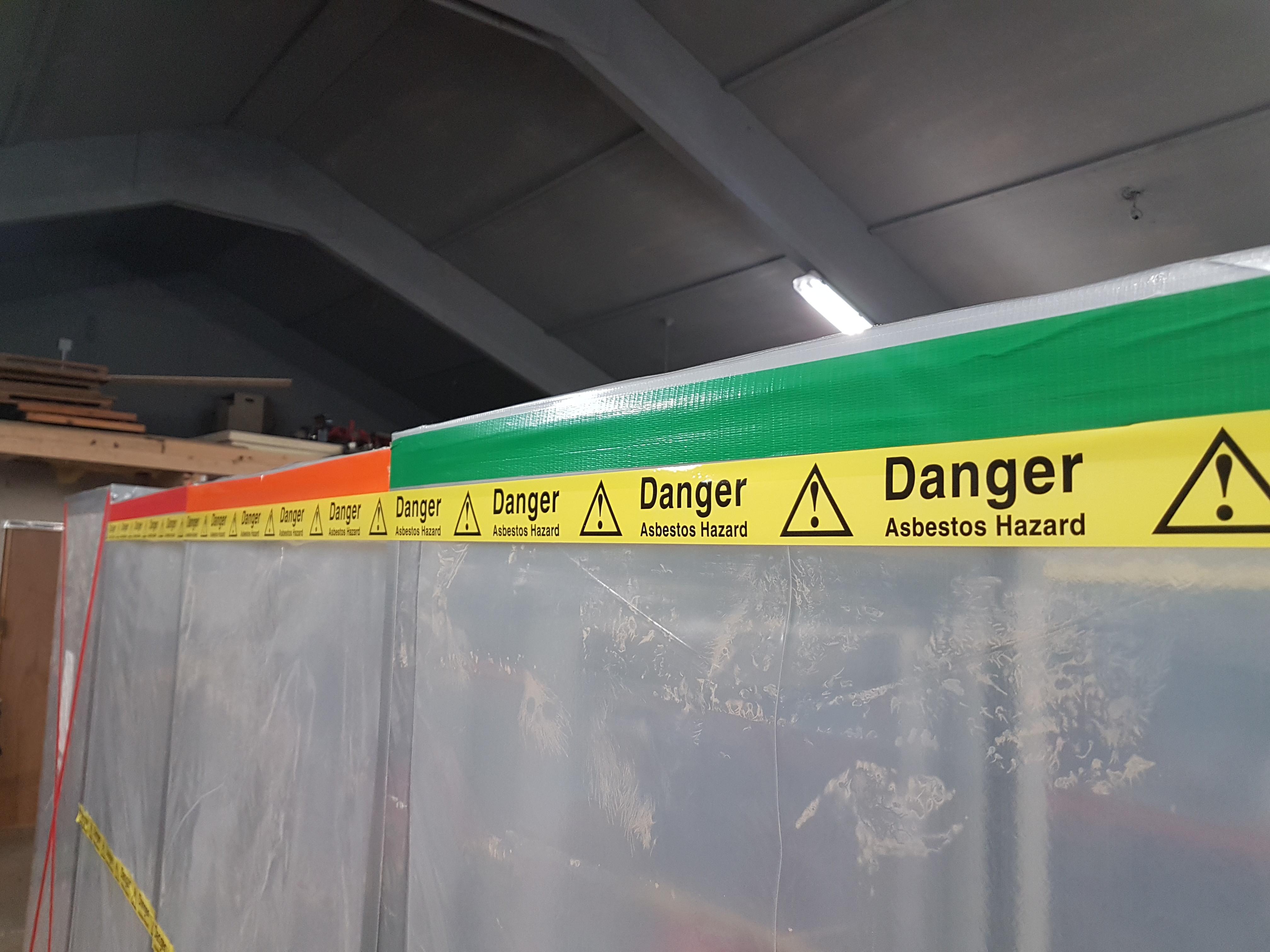 A closeup of asbestos warning tape