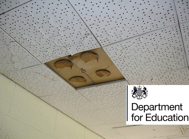 A photo of asbestos ceiling tiles with holes in them